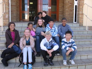 Ambre, Lisa, Juvan, KB, Chante, Rone, Emilio, Chanson and our two puppeteers on the steps of Emil Weder High School Genadendal.