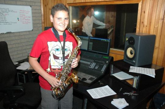 Corne van Dyk with his sax in studio.